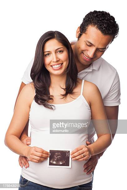 Cheerful couple holding an ultrasound