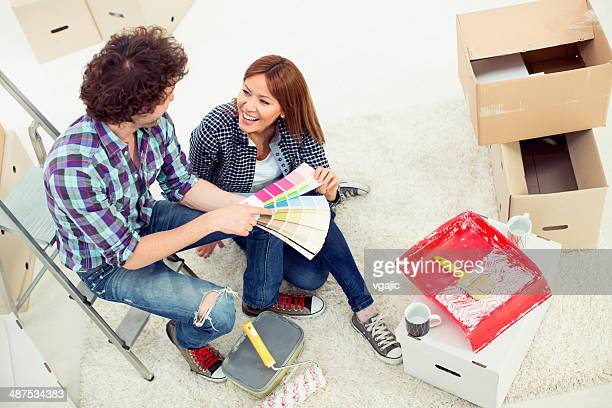 Cheerful Couple Renovating Their Appartment.
