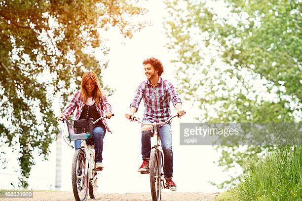 Cheerful Couple Riding Bicycle Together In A Nature.