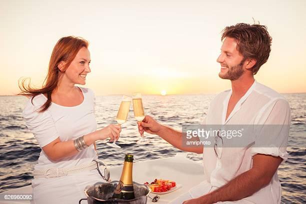 cheerful couple sea sunset dinner