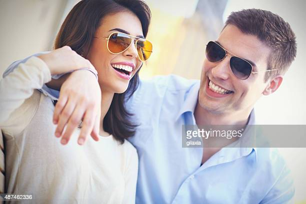 Cheerful couple with sunglasses.