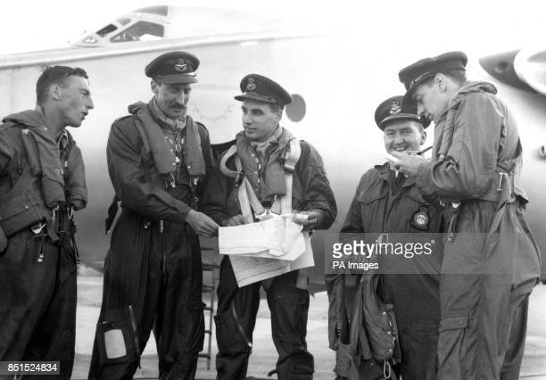 Cheerful crew of a valiant jet bomber are seen in Malta discuss flight plans to Egypt B Conchie of Shepperton Squadron Leader RW Richardson of...