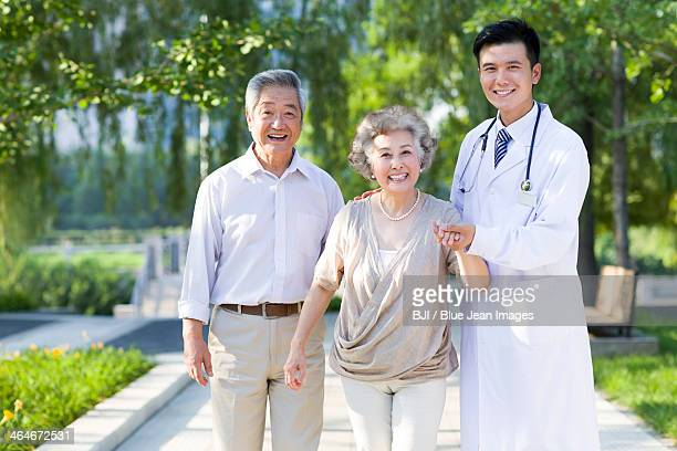 Cheerful doctor with seniors