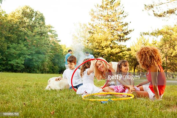 Cheerful Families barbecue outdoors.