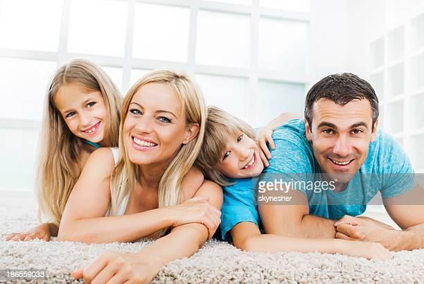 Cheerful family at home.
