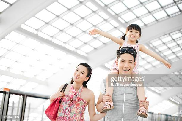 Cheerful family at the airport