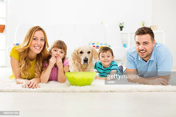Cheerful Family Eating Popcorns and Watching TV.