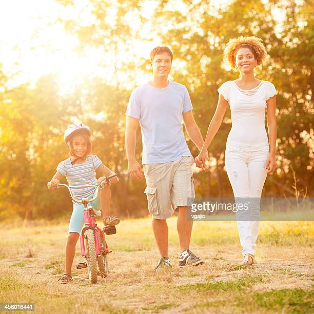 Cheerful Family Enjoy Walking Outdoors.