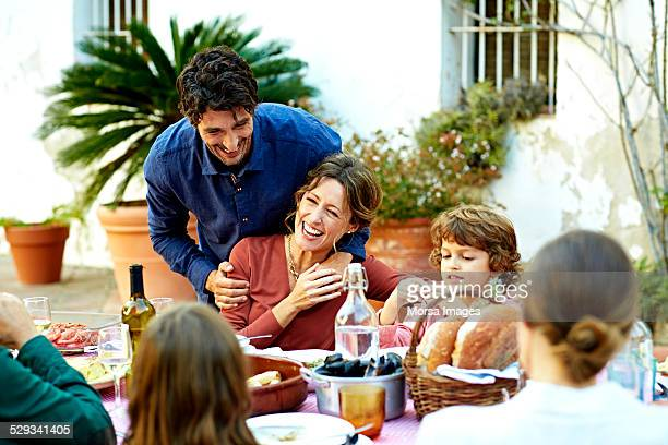 Cheerful family enjoying at outdoor meal table