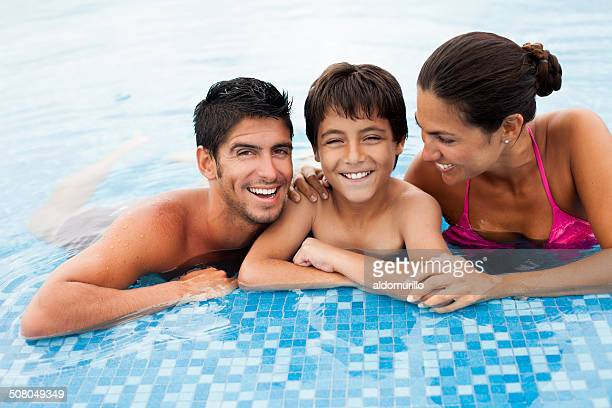Cheerful family in a swimming pool