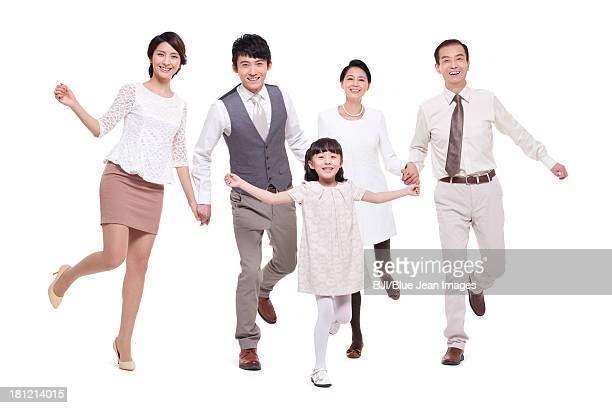 Cheerful family jumping in the mid-air