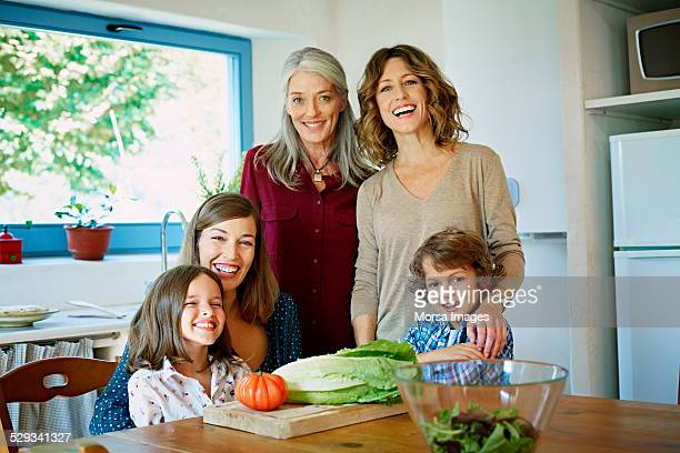 Cheerful family preparing food in kitchen