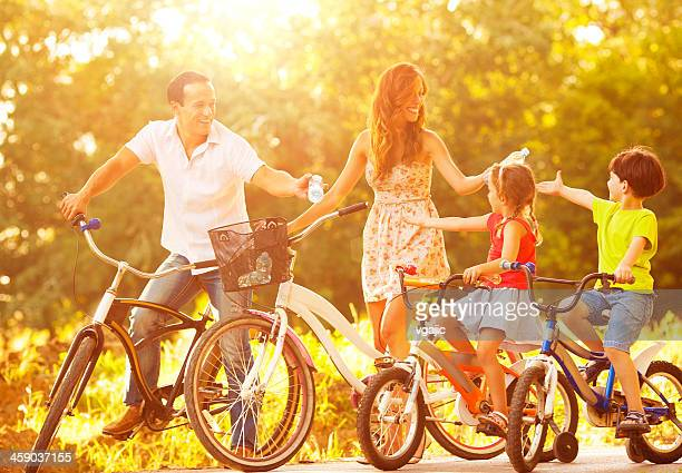 Cheerful Family Riding Bicycles Outdoors.