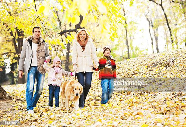 Cheerful family walking in park.