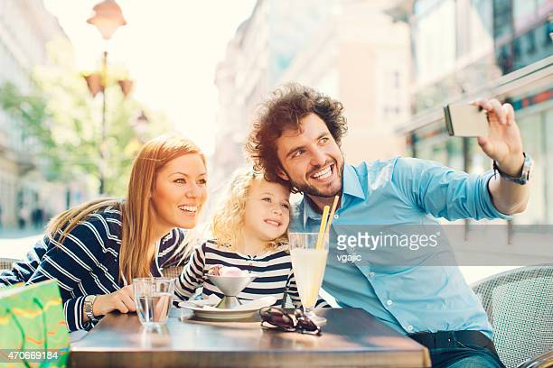 Cheerful Family With Little Girl Making Selfie.