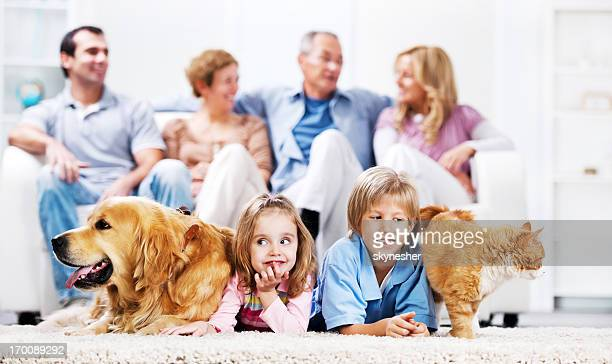 Cheerful family with pets