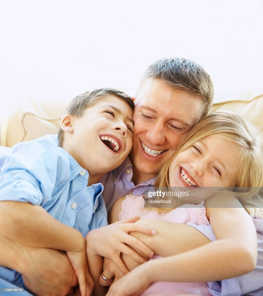 Cheerful father and children having fun : Stock Photo