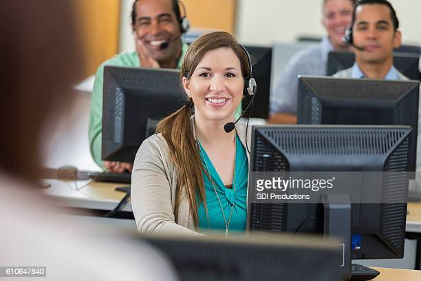 Cheerful female call center operator
