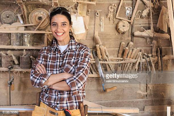 Cheerful female carpenter