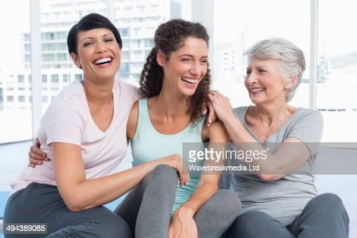 Cheerful fit women in yoga class : Stock Photo