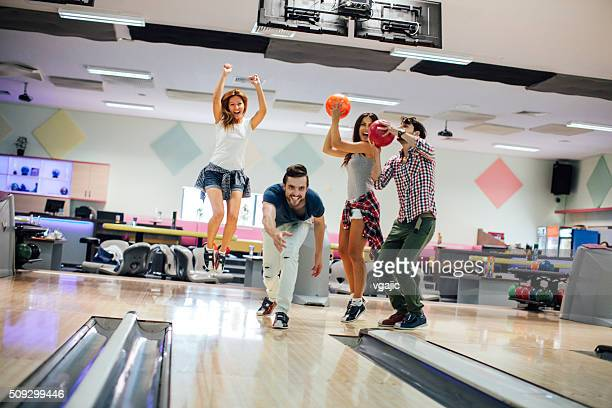 Cheerful Friends Bowling Together