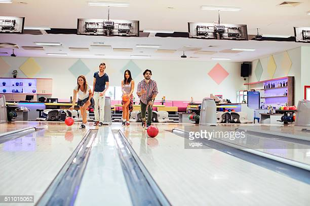 Cheerful Friends Bowling Together.