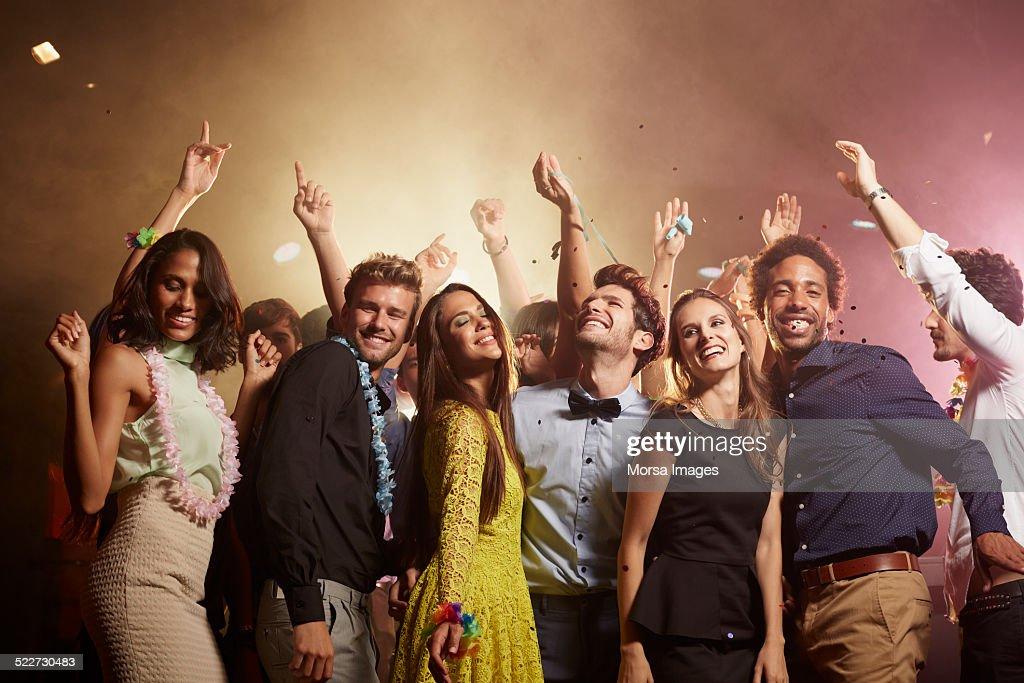 Cheerful friends enjoying at nightclub
