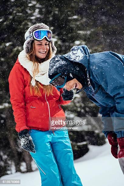 Cheerful friends having fun in snow