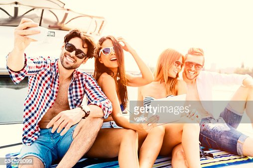 Cheerful Friends Making Selfie On Yacht.