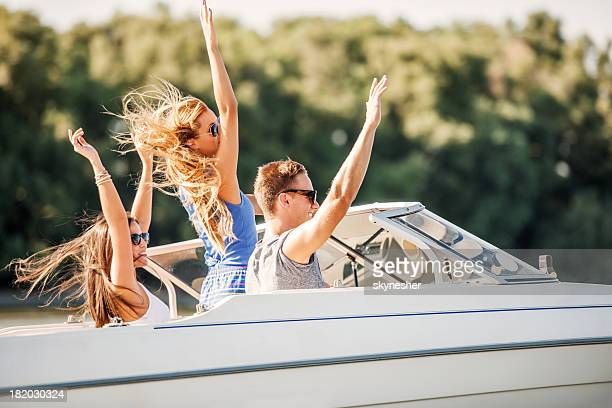 Cheerful friends on a speedboat.