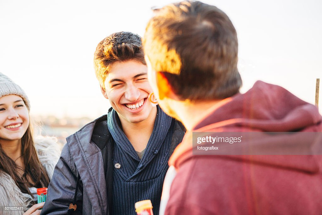 cheerful friends relax together, laughing young men