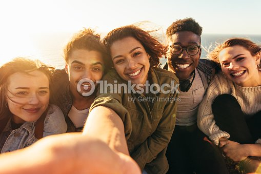 Cheerful friends taking selfie on a holiday : Stock Photo