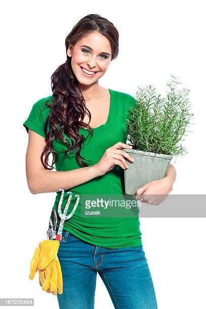 Cheerful gardener with herbs