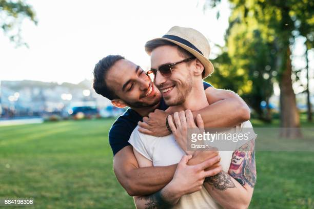 Cheerful gay couple expressing love to each other while on vacation