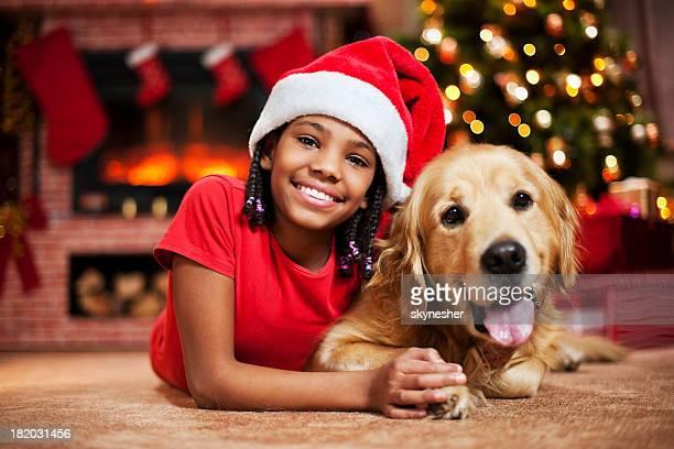 Cheerful girl celebrating Christmas with her dog.