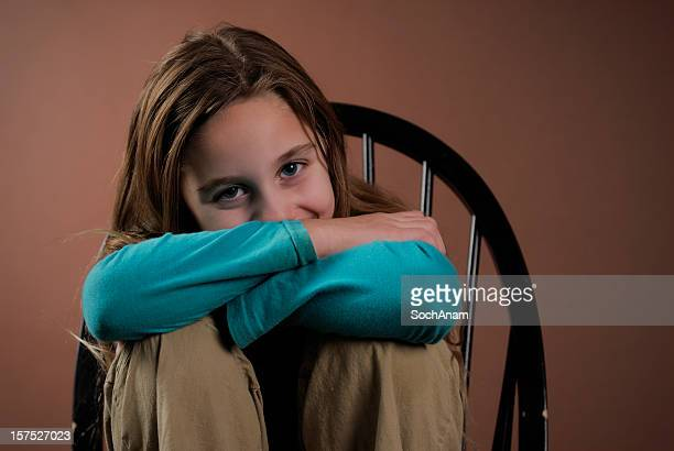 Cheerful Girl Hiding Behind Arms