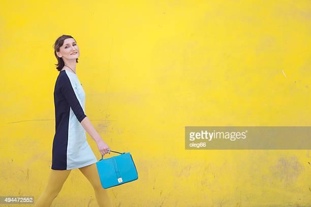 cheerful girl with a handbag