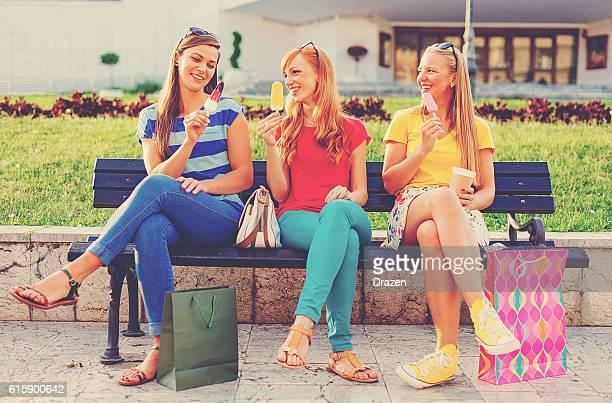 Cheerful girls eating ice-cream