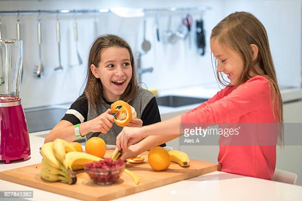 Cheerful girls in the kitchen