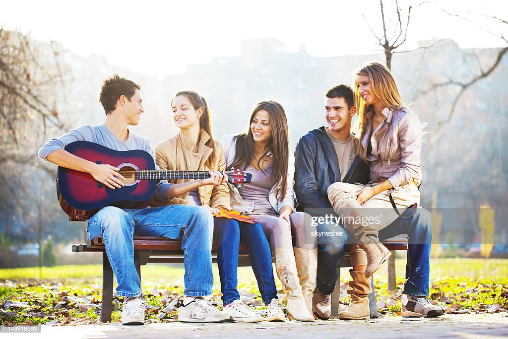 Cheerful group of friend enjoying in the guitar sound. : Stock Photo