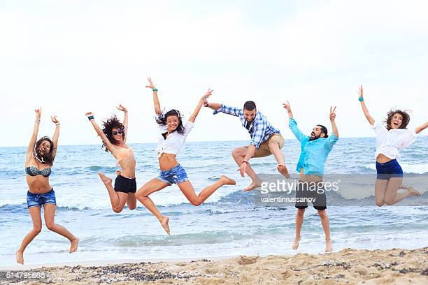 Cheerful group of friends on beach