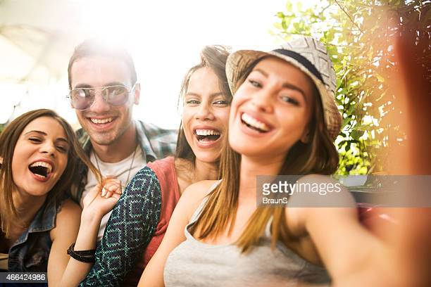 Cheerful group of friends taking a selfie.