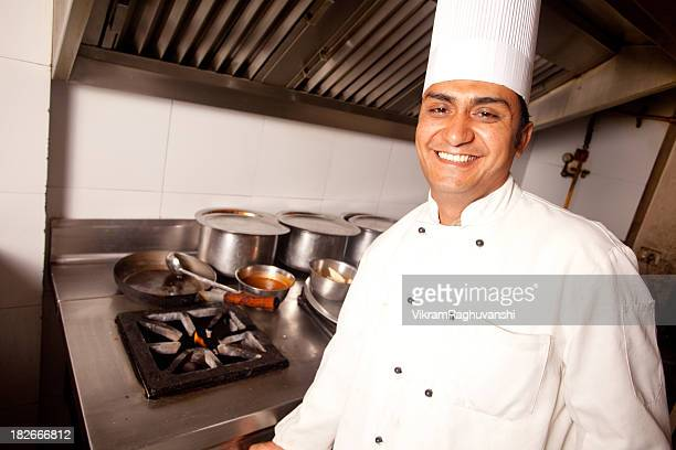 Cheerful Indian Chef working cooking in a Restaurant Kitchen Horizontal