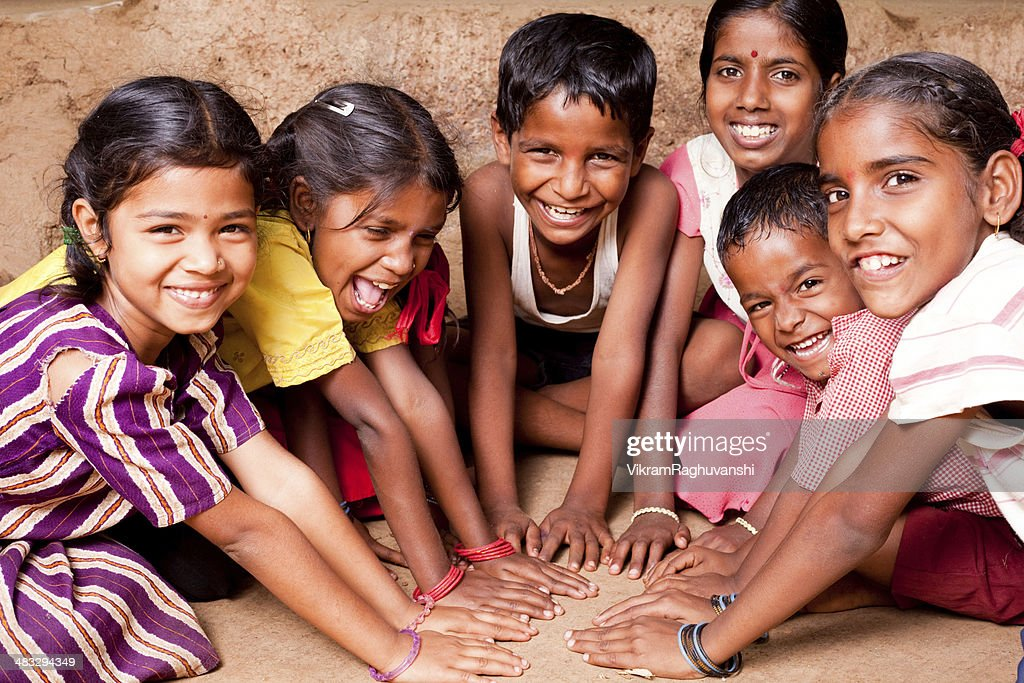 Group of Six Cheerful Rural Indian Children joining hands