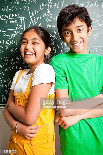 Cheerful Indian Teenager Boy and Girl Student with Mathematics Problems
