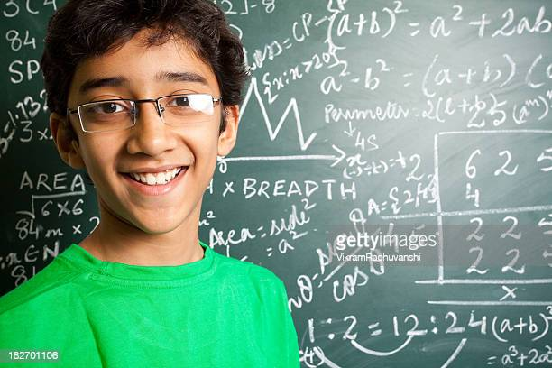 Cheerful Indian Teenager Student with Mathematics Problems