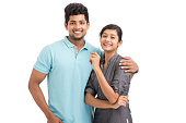 Cheerful Indian young couple on white background.