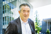 Cheerful Japanese senior man in modern Tokyo urban setting