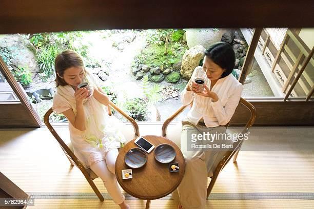 Cheerful Japanese women having a meeting in a tea house
