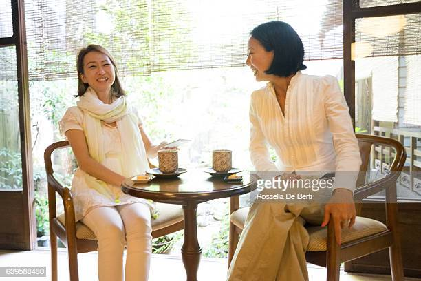 Cheerful Japanese women having a meeting in a traditional cafè